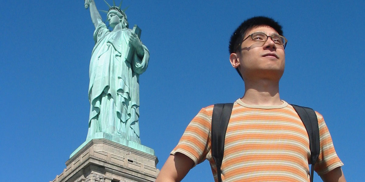 Photo of Jun with Statue of Liberty